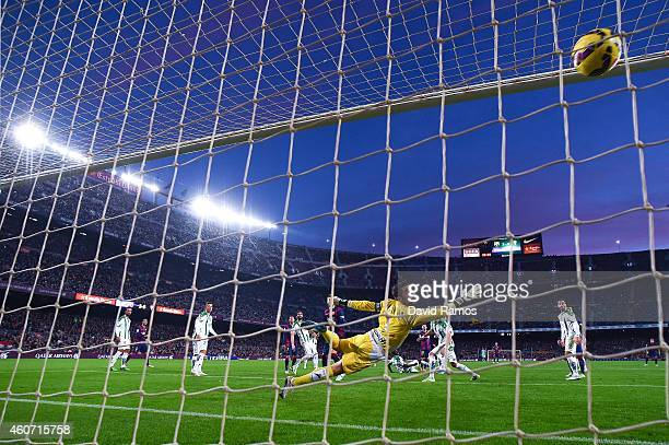 Lionel Messi of FC Barcelona scores his team's fourth goal during the La Liga match between FC Barcelona and Cordoba CF at Camp Nou on December 20...