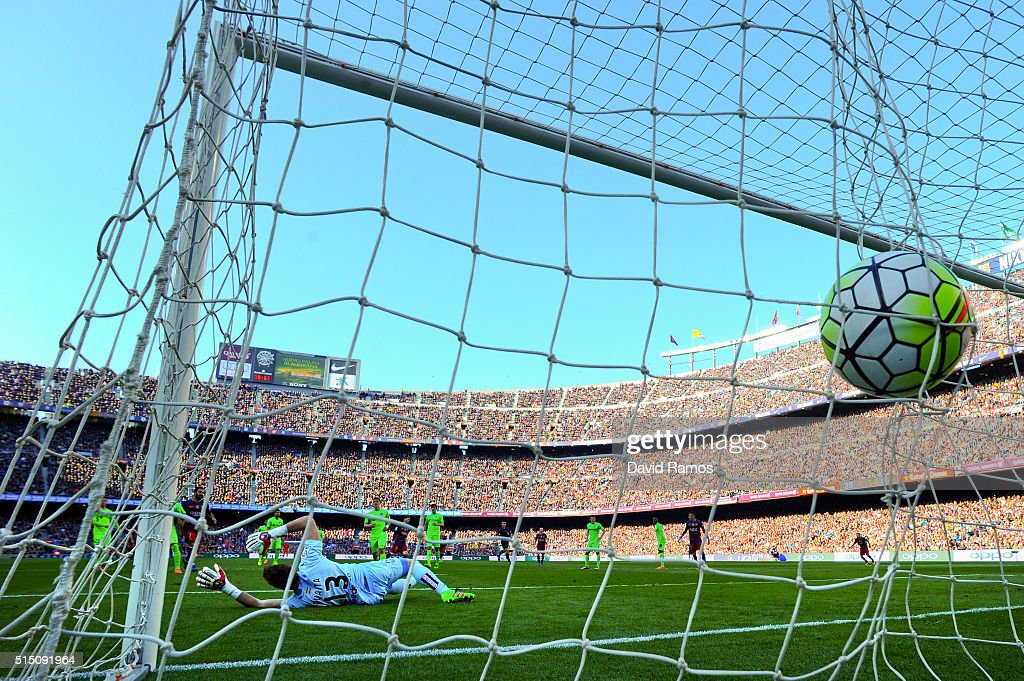 Lionel Messi of FC Barcelona scores his team's fourth goal during the La Liga match between FC Barcelona and Getafe CF at Camp Nou on March 12, 2016 in Barcelona, Spain.