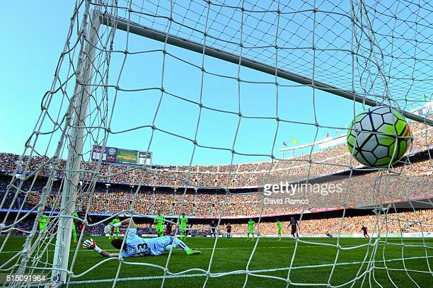 Lionel Messi of FC Barcelona scores his team's fourth goal during the La Liga match between FC Barcelona and Getafe CF at Camp Nou on March 12 2016...