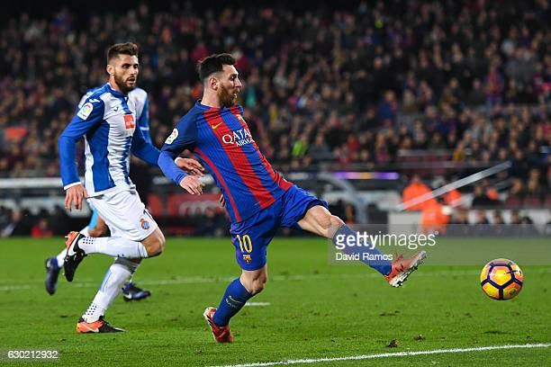 Lionel Messi of FC Barcelona scores his team's fourth goal during the La Liga match between FC Barcelona and RCD Espanyol at the Camp Nou stadium on...