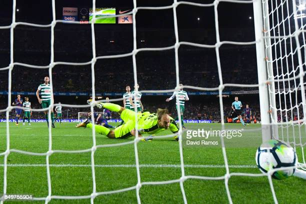 Lionel Messi of FC Barcelona scores his team's fourth goal during the La Liga match between Barcelona and SD Eibar at Camp Nou on September 19 2017...