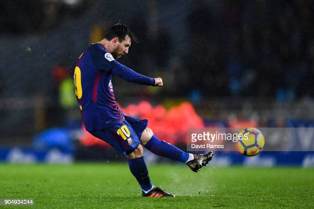 Lionel Messi of FC Barcelona scores his team's fourth goal during the La Liga match between Real Sociedad and FC Barcelona at Anoeta stadium on...