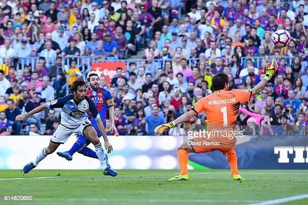 Lionel Messi of FC Barcelona scores his team's fourth goal past Alejandro Arribas of RC Deportivo La Coruna during the La Liga match between FC...