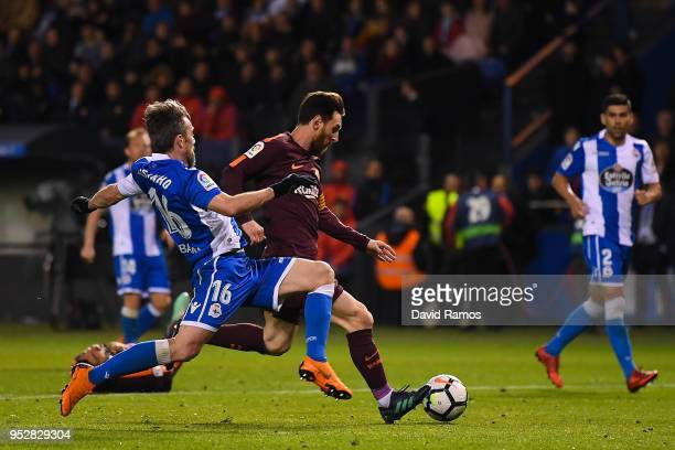 Lionel Messi of FC Barcelona scores his team's fourth goal past Luisinho Correia of RC Deportivo La Coruna during the La Liga match between Deportivo...