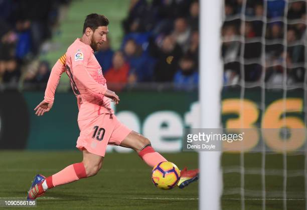 Lionel Messi of FC Barcelona scores his team's opening goal during the La Liga match between Getafe CF and FC Barcelona at Coliseum Alfonso Perez on...