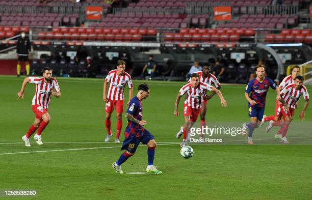 Lionel Messi of FC Barcelona scores his team's second goal and his 700th career goal by penalty against Goalkeeper Jan Oblak of Atletico Madrid...