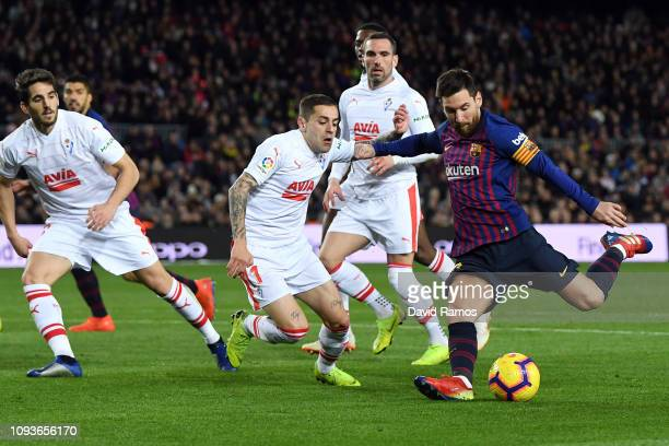 Lionel Messi of FC Barcelona scores his team's second goal during the La Liga match between FC Barcelona and SD Eibar at Camp Nou on January 13, 2019...