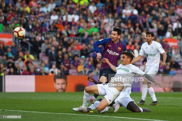 Lionel Messi of FC Barcelona scores his team's second goal during the La Liga match between FC Barcelona and Getafe CF at Camp Nou on May 12 2019 in...