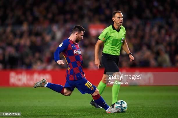 Lionel Messi of FC Barcelona scores his team's second goal during the La Liga match between FC Barcelona and RC Celta de Vigo at Camp Nou stadium on...