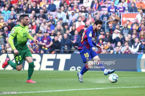 Lionel Messi of FC Barcelona scores his team's second goal during the La Liga match between FC Barcelona and SD Eibar SAD at Camp Nou on February 22,...