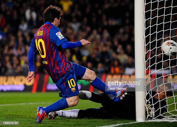 Lionel Messi of FC Barcelona scores his team's second goal during the La Liga match between FC Barcelona and Valencia CF at Camp Nou stadium on...