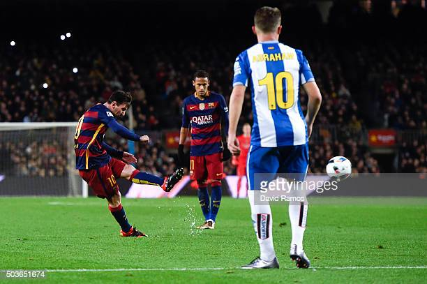 Lionel Messi of FC Barcelona scores his team's second goal during the Copa del Rey Round of 16 first leg match between FC Barcelona and RCD Espanyol...