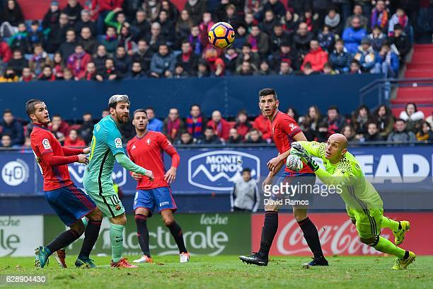 Lionel Messi of FC Barcelona scores his team's second goal during the La Liga match between CA Osasuna and FC Barcelona at Sadar stadium on December...