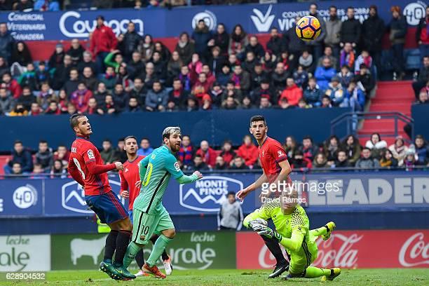 Lionel Messi of FC Barcelona scores his team's second goal during the La Liga match between CA Osasuna and FC Barcelona at Sadar stadium on December...