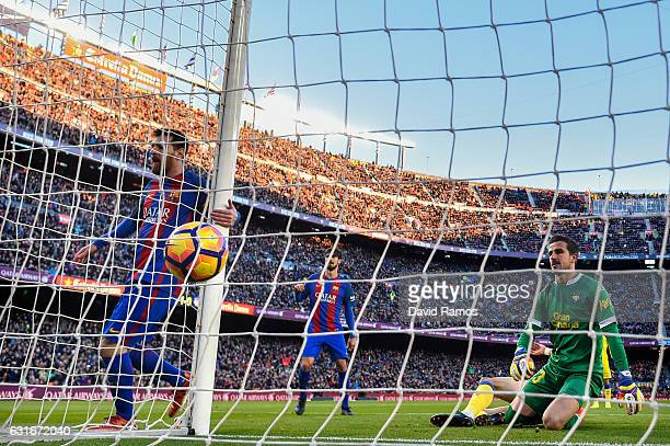Lionel Messi of FC Barcelona scores his team's second goal during the La Liga match between FC Barcelona and UD Las Palmas at Camp Nou stadium on...