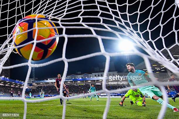 Lionel Messi of FC Barcelona scores his team's second goal during the La Liga match between SD Eibar and FC Barcelona at Ipurua stadium on January 22...