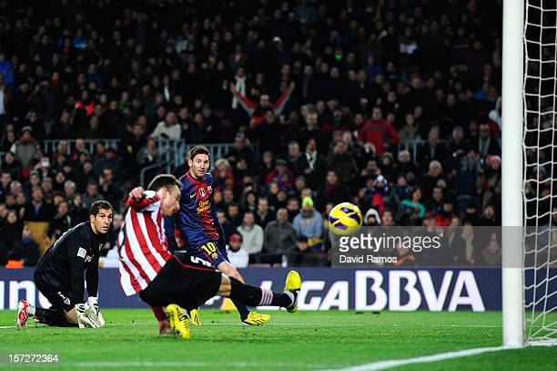 Lionel Messi of FC Barcelona scores his team's second goal past Gorka Iraizoz of Athletic Club during the La Liga match between FC Barcelona and...