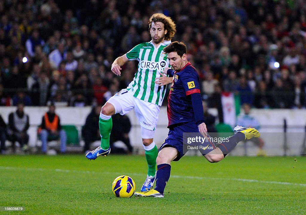 Lionel Messi of FC Barcelona scores his team's second goal past Jose Alberto Canas of Real Betis Balompie, during the La Liga match between Real Betis Balompie and FC Barcelona at Estadio Benito Villamarin on December 9, 2012 in Seville, Spain. With this goal Lionel Messi beats the 1972 scoring record set by Gerd Muller of 85 goals in one year.