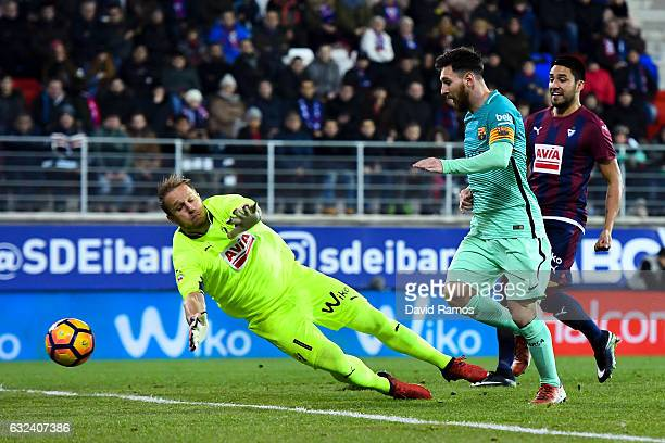 Lionel Messi of FC Barcelona scores his team's second goal past the goalkeeper Yoel of SD Eibar during the La Liga match between SD Eibar and FC...