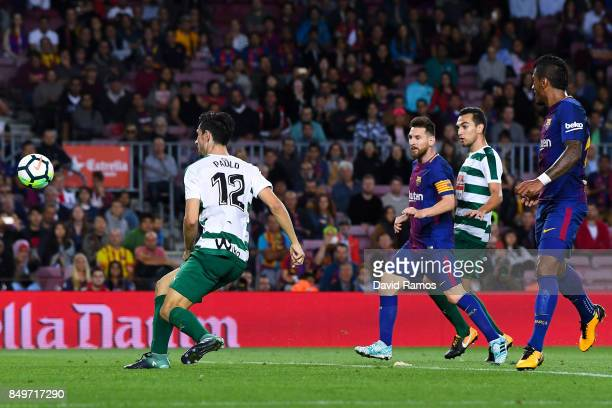 Lionel Messi of FC Barcelona scores his team's sixth goal during the La Liga match between Barcelona and SD Eibar at Camp Nou on September 19 2017 in...