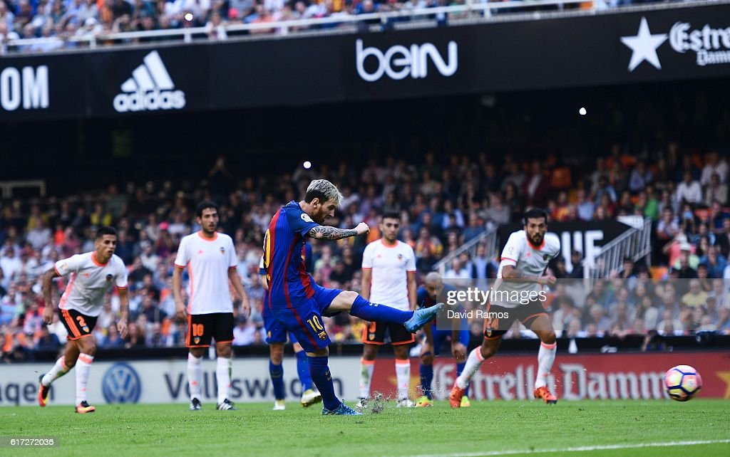 Lionel Messi of FC Barcelona scores his team's third from the penalty spot goal during the La Liga match between Valencia CF and FC Barcelona at Mestalla stadium on October 22, 2016 in Valencia, Spain.