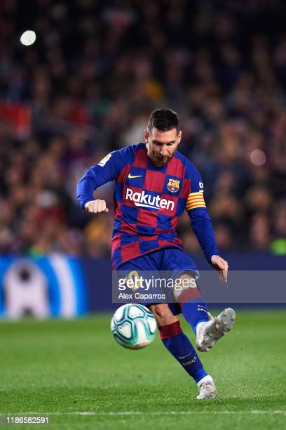 Lionel Messi of FC Barcelona scores his team's third goal during the La Liga match between FC Barcelona and RC Celta de Vigo at Camp Nou stadium on...