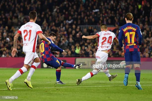Lionel Messi of FC Barcelona scores his team's third goal during the Liga match between FC Barcelona and RCD Mallorca at Camp Nou on December 07 2019...