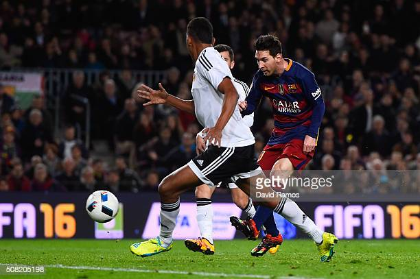 Lionel Messi of FC Barcelona scores his team's third goal during the Copa del Rey Semi Final first leg match between FC Barcelona and Valencia at Nou...