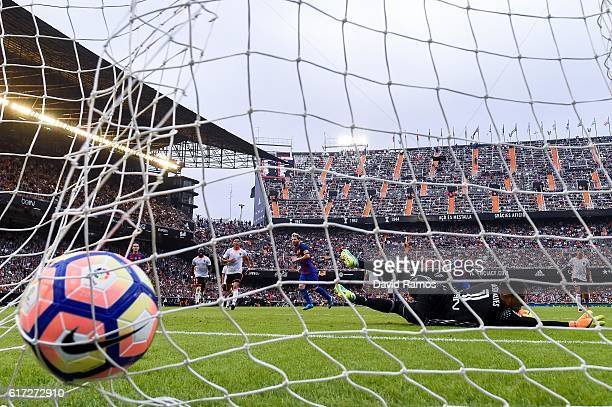 Lionel Messi of FC Barcelona scores his team's third goal from the penalty spot during the La Liga match between Valencia CF and FC Barcelona at...