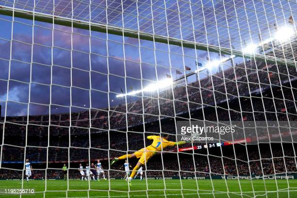 Lionel Messi of FC Barcelona scores his team's third goal past goalkeeper Fernando Pacheco of Deportivo Alaves during the La Liga match between FC...