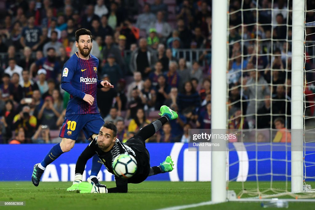 Lionel Messi of FC Barcelona scores his team's third goal past Segio Asenjo of Villarreal CF during the La Liga match between Barcelona and Real Madrid at Camp Nou on May 9, 2018 in Barcelona, Spain.