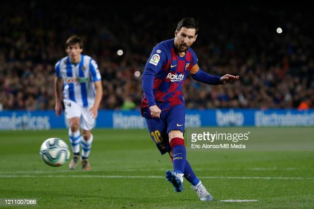 Lionel Messi of FC Barcelona scores the 1-0 from the penalty spot during the Liga match between FC Barcelona and Real Sociedad at Camp Nou on March...