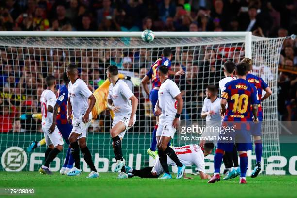 Lionel Messi of FC Barcelona scores the 40 after shoot a free kick during the Liga match between FC Barcelona and Sevilla FC at Camp Nou on October...