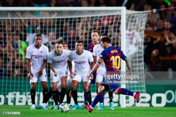 Lionel Messi of FC Barcelona scores the 4-0 after shoot a free kick during the Liga match between FC Barcelona and Sevilla FC at Camp Nou on October...
