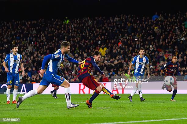 Lionel Messi of FC Barcelona scores the opening goal during the Copa del Rey Round of 16 first leg match between FC Barcelona and RCD Espanyol at...