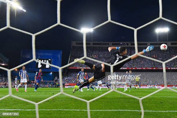 Lionel Messi of FC Barcelona scores the opening goal during the Copa Del Rey Final between FC Barcelona and Deportivo Alaves at Vicente Calderon...