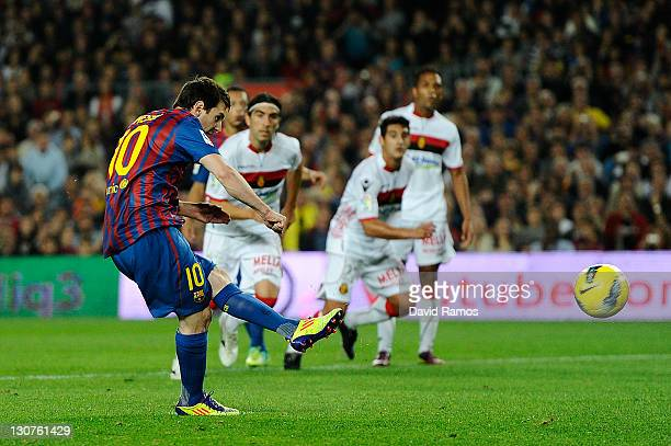 Lionel Messi of FC Barcelona scores the opening goal during the La Liga match between FC Barcelona and RCD mallorca at Camp Nou on October 29 2011 in...