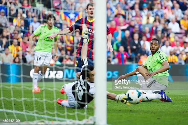 Lionel Messi of FC Barcelona scores the opening goal during the La Liga match between FC Barcelona and CA Osasuna at Camp Nou on March 16 2014 in...