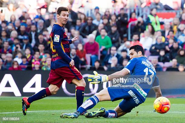 Lionel Messi of FC Barcelona scores the opening goal during the La Liga match between FC Barcelona and Granada CF at Camp Nou on January 9 2016 in...