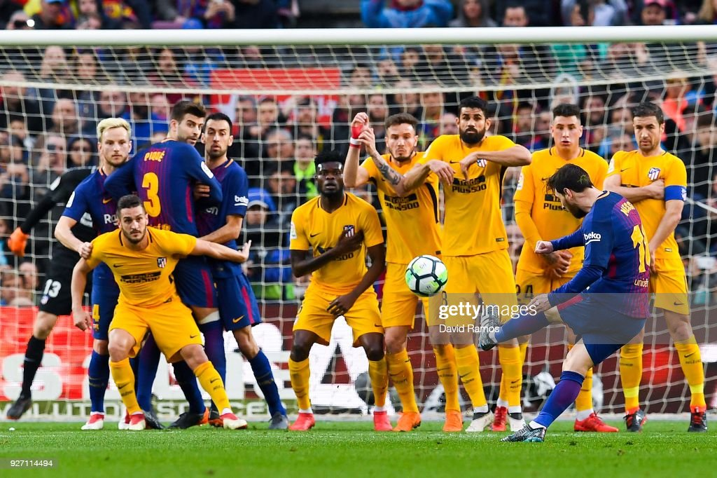 Lionel Messi of FC Barcelona scores the opening goal during the La Liga match between Barcelona and Atletico Madrid at Camp Nou on March 4, 2018 in Barcelona, Spain.