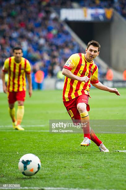 Lionel Messi of FC Barcelona scores the opening goal with a penalty during the La Liga match between RCD Espanyol and FC Barcelona at CornellaEl Prat...