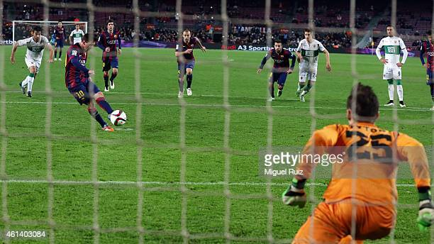 Lionel Messi of FC Barcelona scores the third goal during the Copa del Rey match between FC Barcelona and Elche CF at Camp Nou on January 8 2015 in...