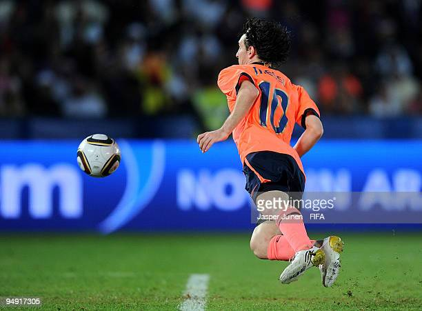 Lionel Messi of FC Barcelona scores the winning 21 goal in extra time during the FIFA Club World Cup Final match between Estudiantes LP and FC...