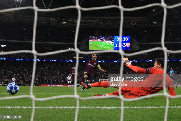 Lionel Messi of FC Barcelona scores their 4th goal during the Group B match of the UEFA Champions League between Tottenham Hotspur and FC Barcelona...