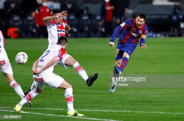 Lionel Messi of FC Barcelona scores their side's second goal during the La Liga Santander match between FC Barcelona and Deportivo Alavés at Camp Nou...