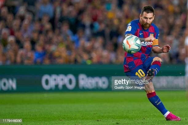 Lionel Messi of FC Barcelona scores their team's fourth goal after this free kick during the Liga match between FC Barcelona and Sevilla FC at Camp...