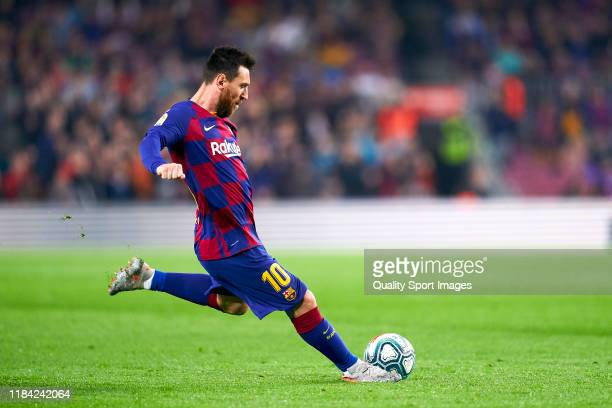 Lionel Messi of FC Barcelona scores their team's third goal from a free kick during the Liga match between FC Barcelona and Real Valladolid CF at...
