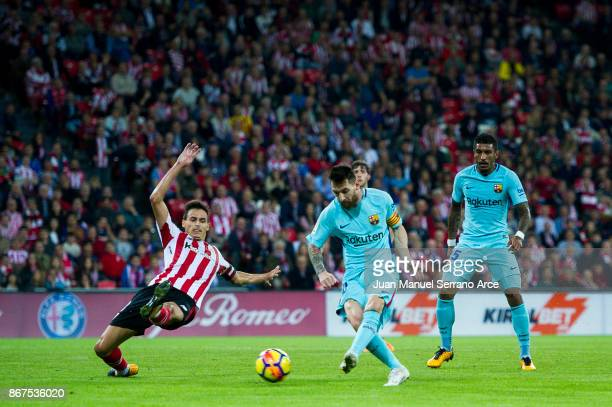 Lionel Messi of FC Barcelona scoring goal during the La Liga match between Athletic Club Bilbao and FC Barcelona at San Mames Stadium on October 28...