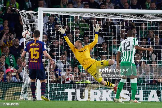Lionel Messi of FC Barcelona scoring his team's first goal during the La Liga match between Real Betis Balompie and FC Barcelona at Estadio Benito...