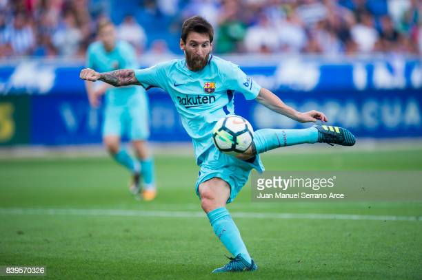 Lionel Messi of FC Barcelona scoring his team's second goal during the La Liga match between Deportivo Alaves and Barcelona at Estadio de...